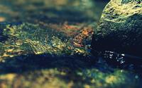 Water flowing around a rock wallpaper 1920x1200 jpg