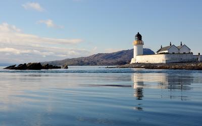 White lighthouse on the shore wallpaper