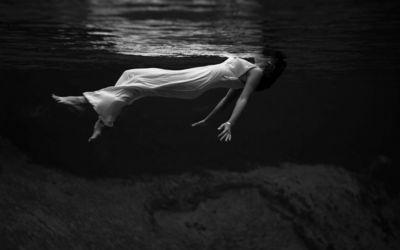 Woman in white dress in the dark water wallpaper