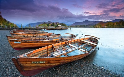 Wooden boats on the pebble beach of the river Wallpaper