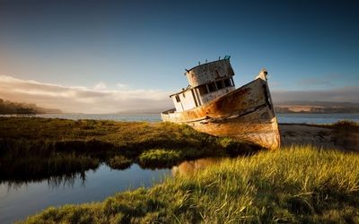 Wooden ship wreck at sunset wallpaper