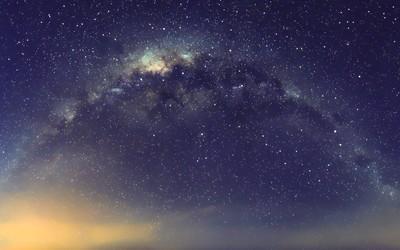 Golden light near the galaxy wallpaper