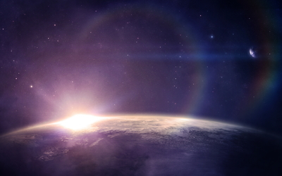 Sun rising from behind the planet wallpaper