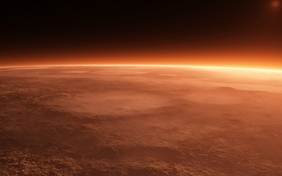 Sun rising from behind the red planet wallpaper