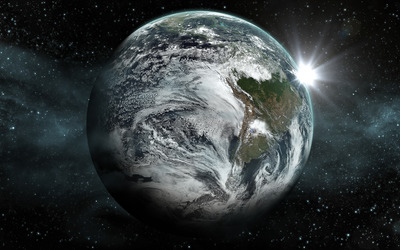 Sun shining behind the planet wallpaper