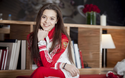 Adelina Sotnikova with a white watch wallpaper