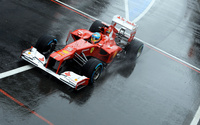 Fernando Alonso during a race in a Scuderia Ferrari wallpaper 2560x1600 jpg