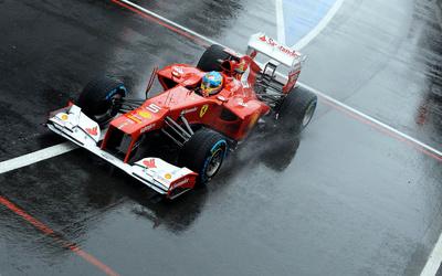 Fernando Alonso during a race in a Scuderia Ferrari wallpaper