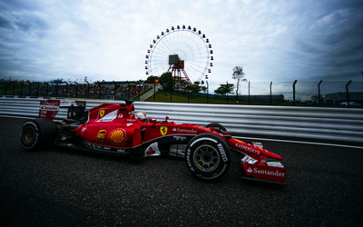 Ferrari SF15-T near a ferris wheel wallpaper