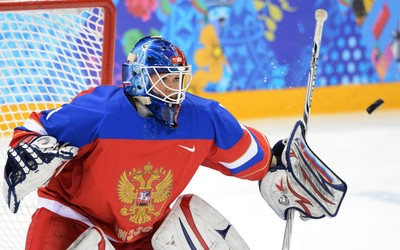 Girl ice hockey player in front of the net wallpaper