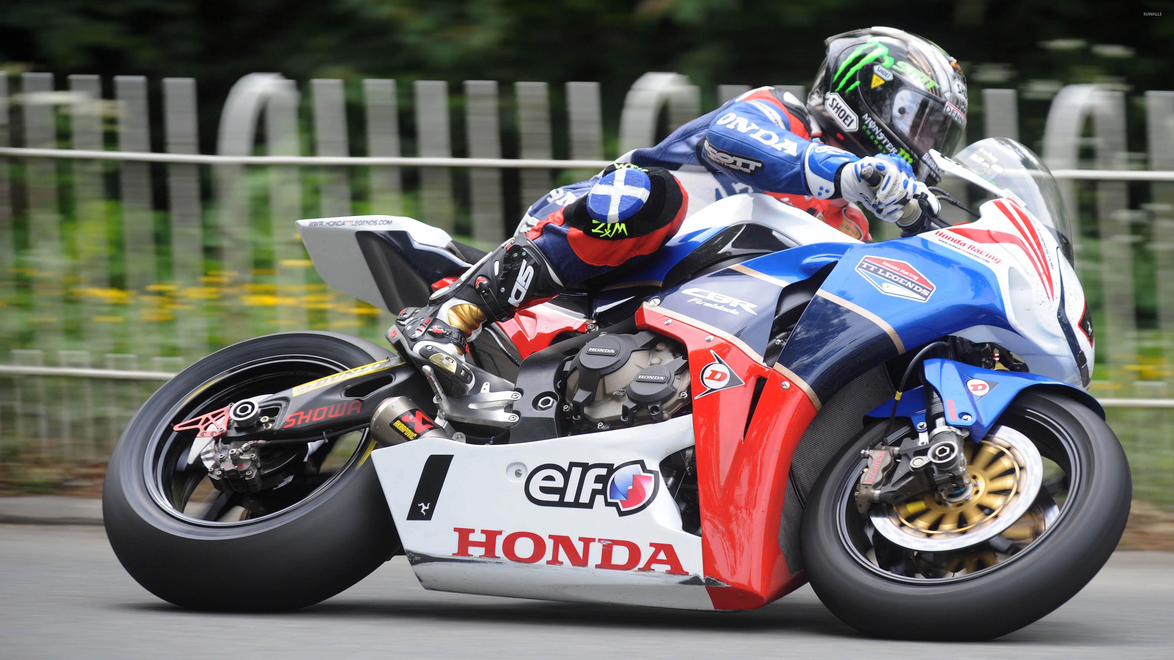 John McGuinness on a Honda during a race wallpaper - Sport wallpapers - #52761