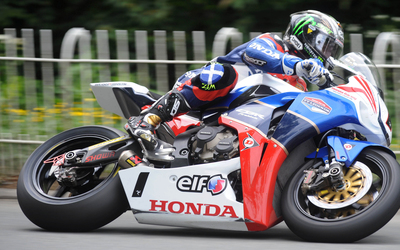 John McGuinness on a Honda during a race wallpaper