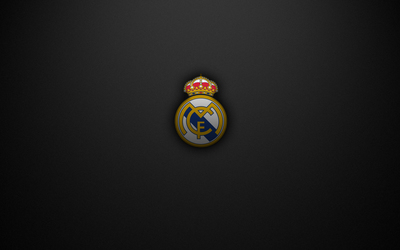 Real Madrid C.F. logo on a black texture background wallpaper
