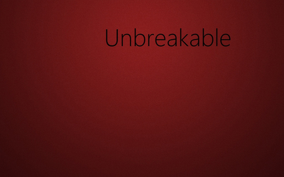 Black unbreakable on red square pattern wallpaper