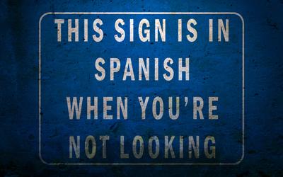 Funny spanish-english sign wallpaper