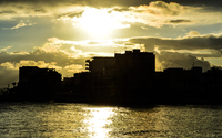 Building silhouettes in the sunset on El Cura beach wallpaper 3840x2160 jpg