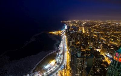 Chicago lights by the dark ocean wallpaper