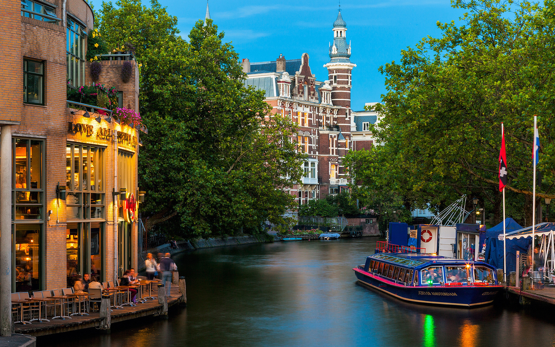 City Of Amsterdam On Amstel River Wallpaper