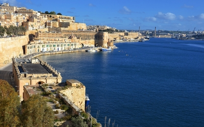 City of Valletta guarded by a stone frotress wallpaper