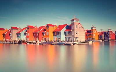 Colorful houses on the river side Wallpaper