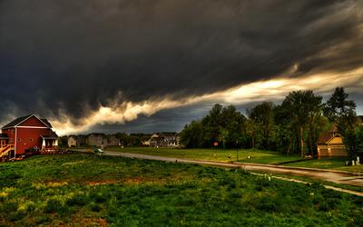 Dark sky above the town Wallpaper