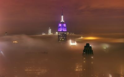 Empire State Building rising above the fog wallpaper