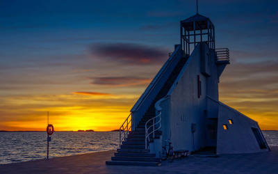 Gorgeous sunset by the lighthouse wallpaper