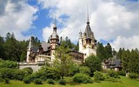 Green forest surrounding Peles Castle wallpaper 1920x1200 jpg