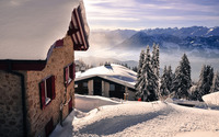 Holiday houses  on a snowy mountain top wallpaper 1920x1200 jpg