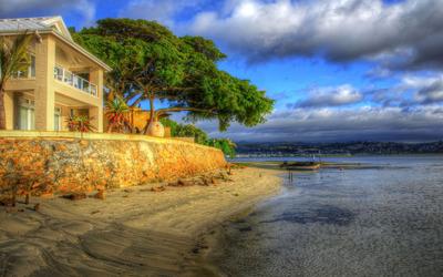 House on sandy beach wallpaper