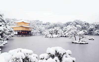 Japanese house on a frozen lake wallpaper
