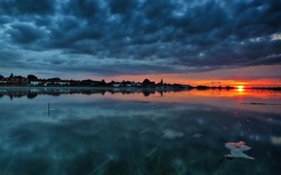 Lakeside town at sunset wallpaper