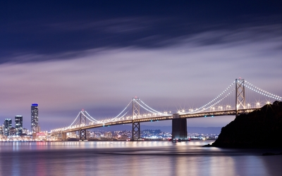 Purple clouds above the San Francisco-Oakland Bay Bridge wallpaper