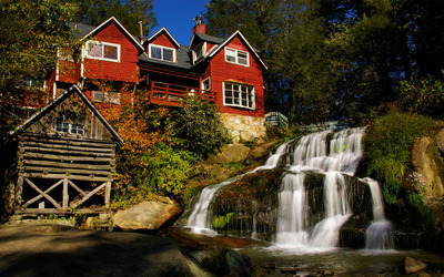 Red house next to the waterfall wallpaper