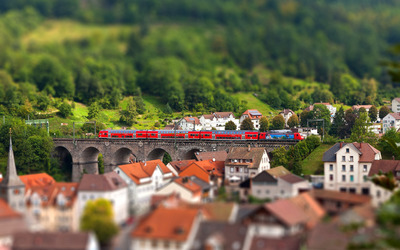 Red train on a stone bridge Wallpaper
