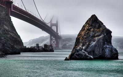 Rocks under the foggy Golden Gate Bridge wallpaper