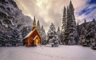 Small church in snowy forest wallpaper