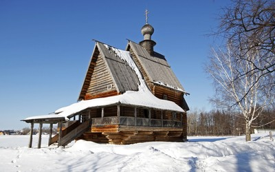 Small wooden church in the snow Wallpaper