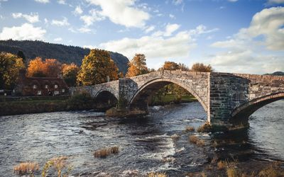 Stone bridge in the village wallpaper