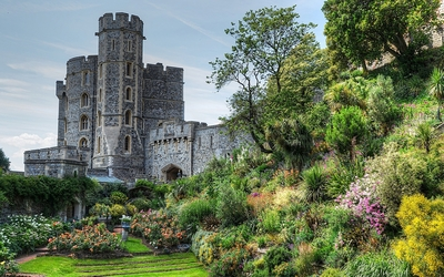 Stone castle with a beautiful garden wallpaper