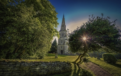 Stone church at sunset Wallpaper