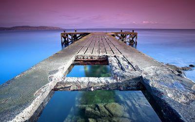 Stone pier towards the purple sunset wallpaper