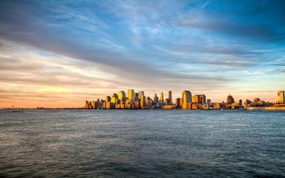 Sunset light over the Manhattan skyscrapers wallpaper