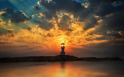 Sunset sun light through the tower of the lighthouse wallpaper