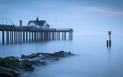Tall pier on the foggy sea Wallpaper