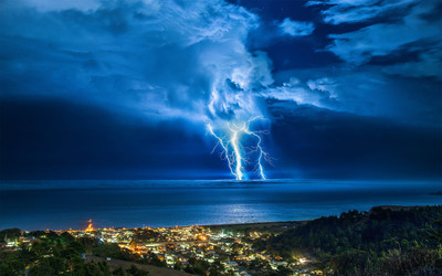 Thunderstorm over the coastal town wallpaper