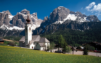 White church in the rocky mountains wallpaper
