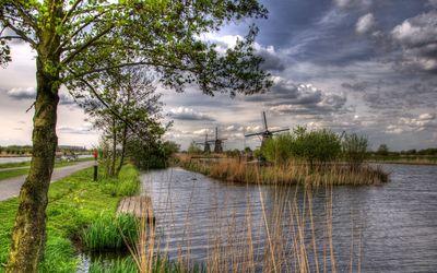 Windmills on the water side wallpaper